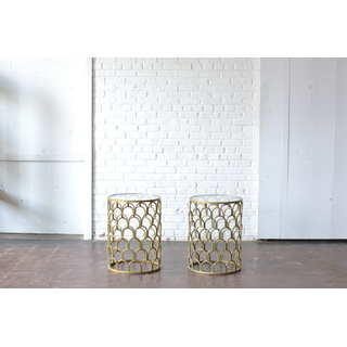 Two modern gold scalloped end tables with glass tops