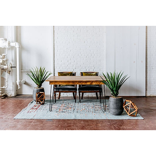 sweetheart seating pants wooden hairpin table blue rug leather chairs geometric prism