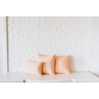 three peach pillows trio
