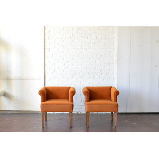 two pair orange velvet and leather upholstered chairs