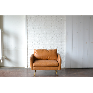 Tan leather mid centery chair with gold legs
