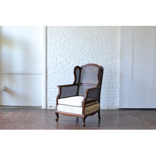 caned wooden high back chair neutral upholstery