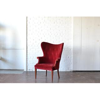 classic wingback velvet chair on white backround