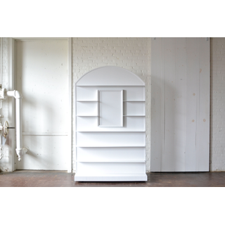 White painted wooden arched display wall