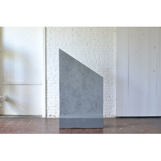 geometric gray concrete panel backdrop