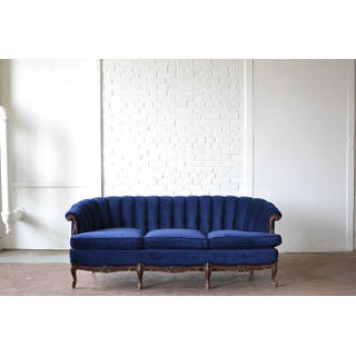 wingback sofa wood trim dark blue upholstered