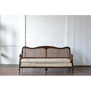 caned wood sofa neutral upholstery