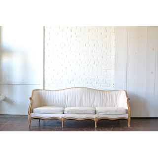 neutral curved back upholstered sofa victorian