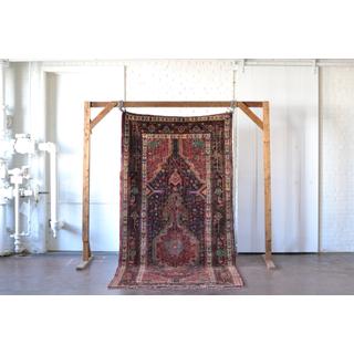 vintage jewel-toned, burgandy rug on white background
