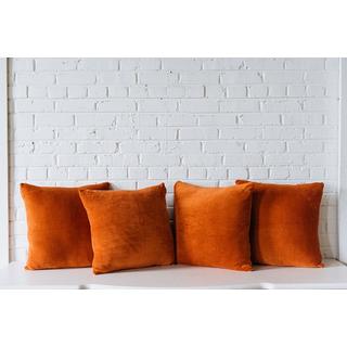 four orange terracotta square pillows