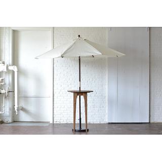 wooden cocktail table neutral canvas umbrella