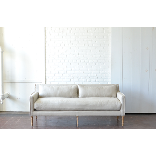 Neutral tan linen sofa