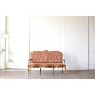 pink peach vintage velvet sofa gold detail on white backround