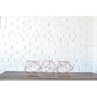trio three geometric copper shapes