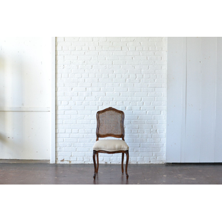 caned wooden side chair neutral upholstery