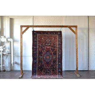 large jewel toned rug on white background