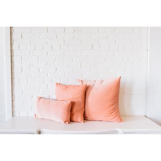 three trio pink coral velvet pillows on white backround