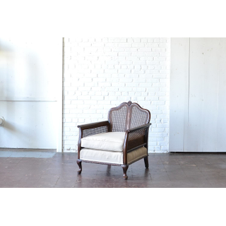 caned wooden chair neutral upholstery