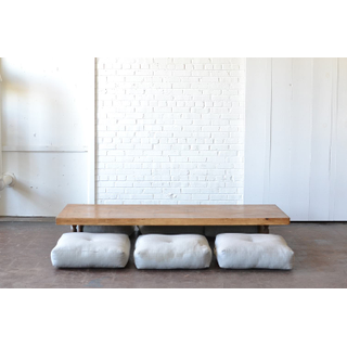 low-set table and neutral gray floor cushions