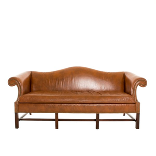 caramel leather sofa with rolled arms and nailhead details