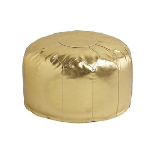 circular gold pouf with gold trim