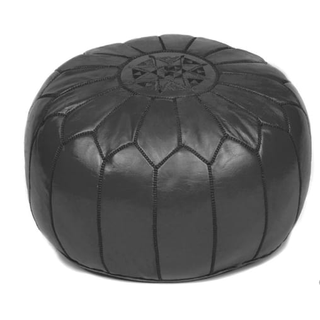 circular black leather pouf with black stiching