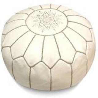 circular white leather pouf with tan stiching