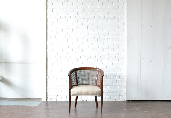 caned wooden barrel chair neutral upholstery