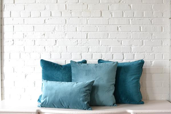 collection of blue velvet pillows