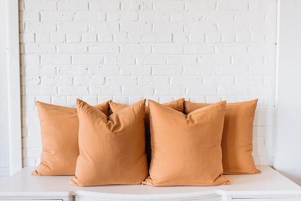 FIve Large Square Tan Pillows