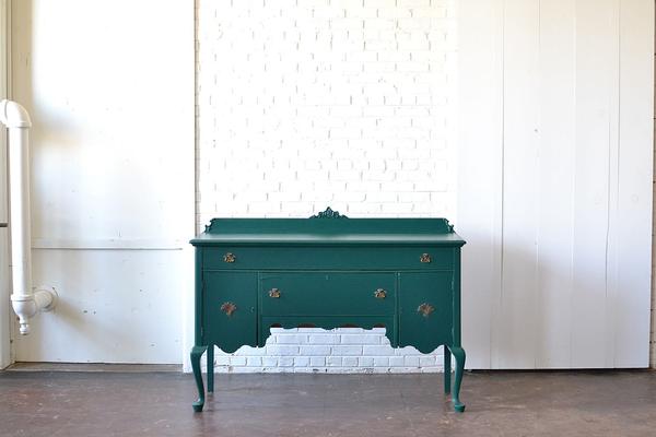 emerald wodden sideboard on white background