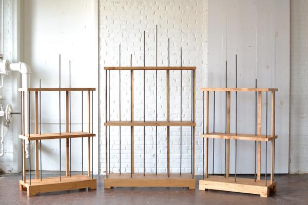 trio three modern wooden shelves on white backround