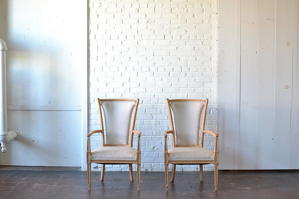 neutral upholstered chairs wooden