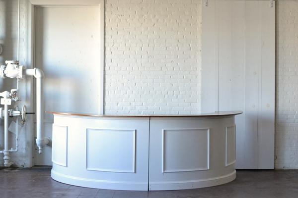 white wooden half round bar