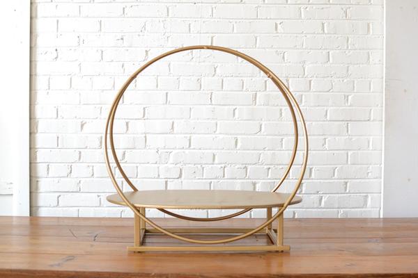gold round tabletop shelf