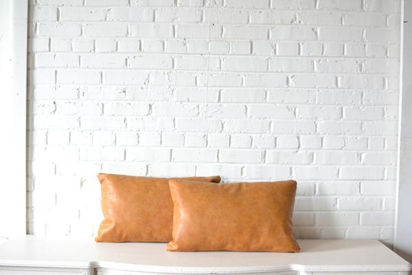 Light tan leather rectanguler pillows