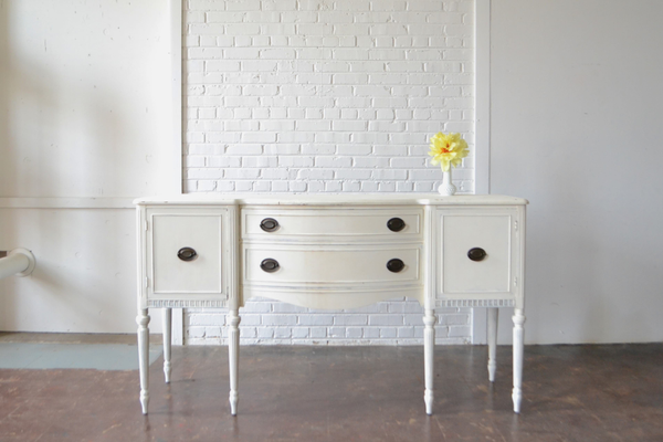 white wooden sideboard on white background
