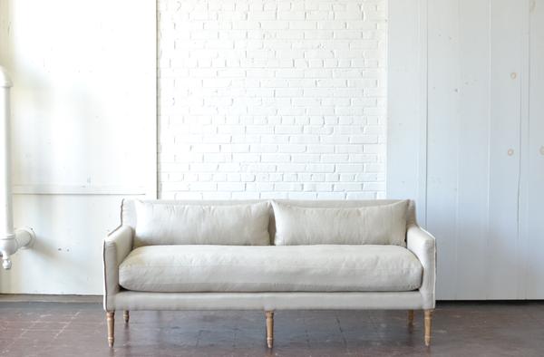 Neutral tan linen sofa