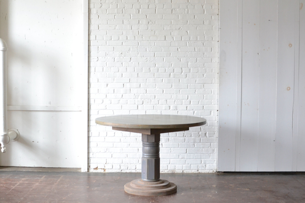Honey gray washed round wooden table