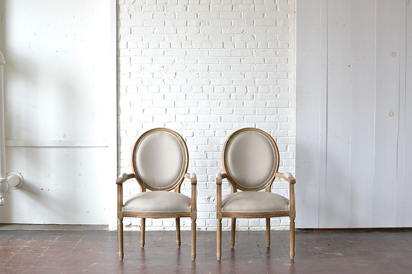 neutral linen upholstered wooden side chairs