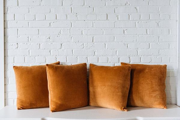 four Camel brown Velvet Pillows