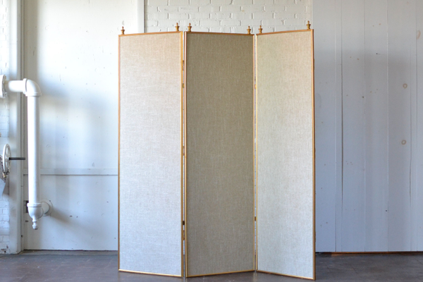 Gold room divider with neutral fabric