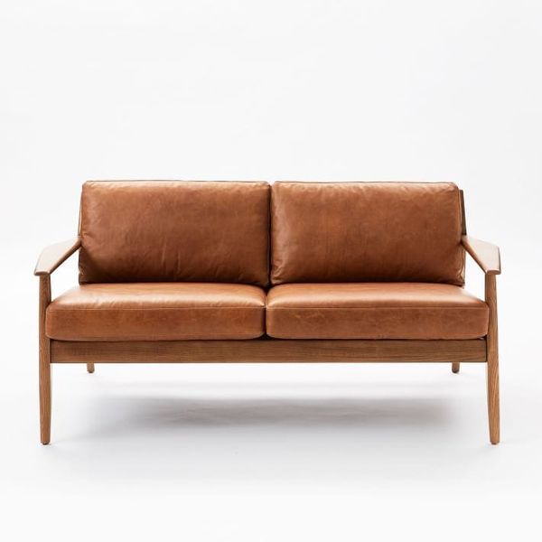 mid-century settee with exposed oak wood frame and comfy leather cushions