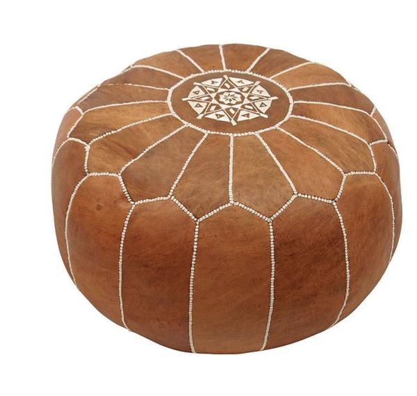 tan moroccan pouf, circular with white stiching
