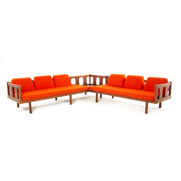 mid-century L shaped sofa lounger, bright redish orange with wood panels