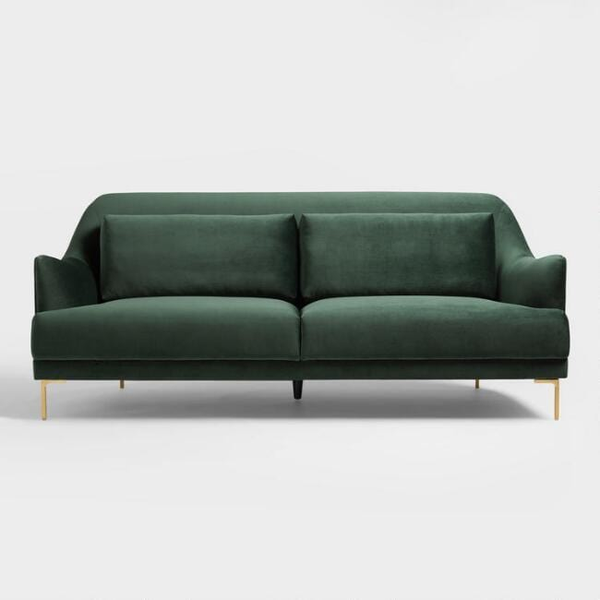 lovely forest green sofa with sleek gold legs