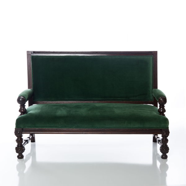 vintage German emerald green loveseat with intricate woodwork