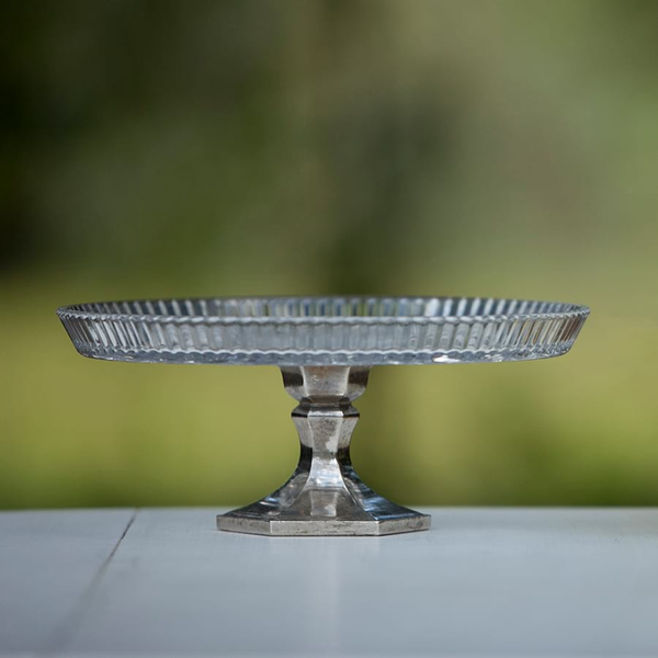 glass top and silver bottom cake stand