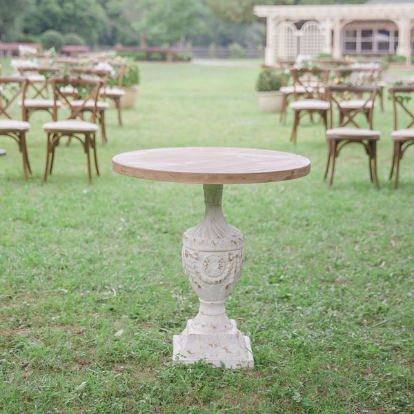 French plaster table with wood top at wedding ceremony with Sonoma chairs in background at The Space at Feather Oaks.