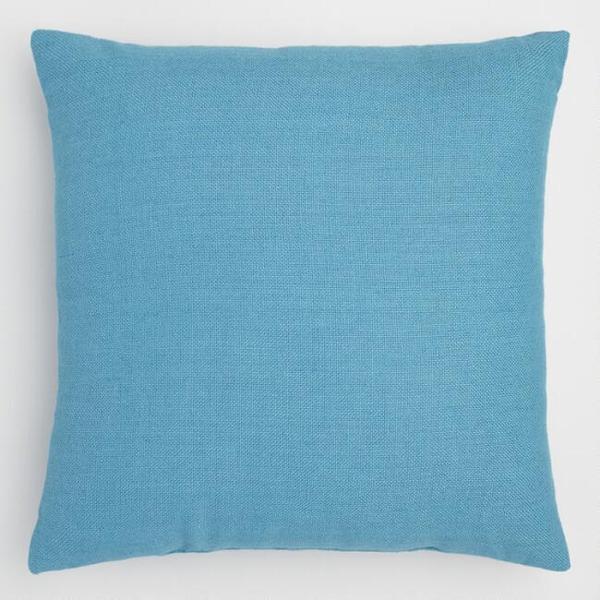 blue woven pillow